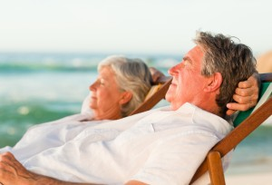 Older-couple-lying-back-at-beach